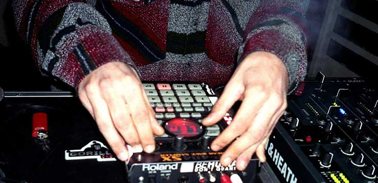 Odeeno making beats on a Roland SP-404